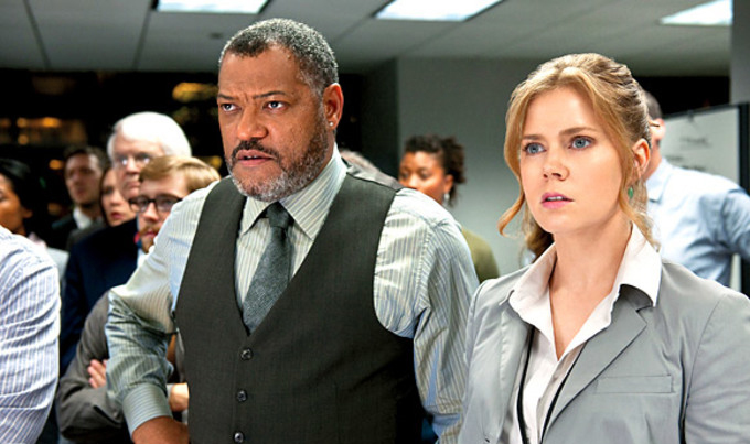 Laurence Fishburne and Amy Adams as The Daily Planet's Perry White and Lois Lane.