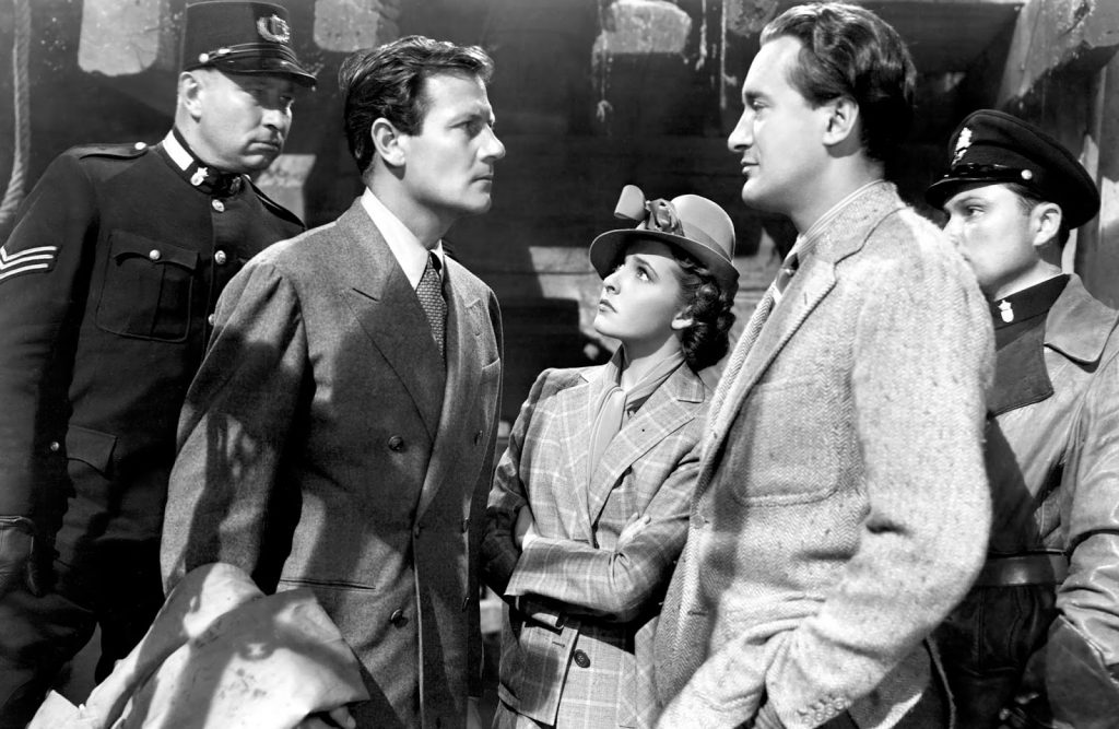 George Sanders and Laraine Day star  in Foreign Correspondent, a suspense thriller by Alfred Hitchcock
