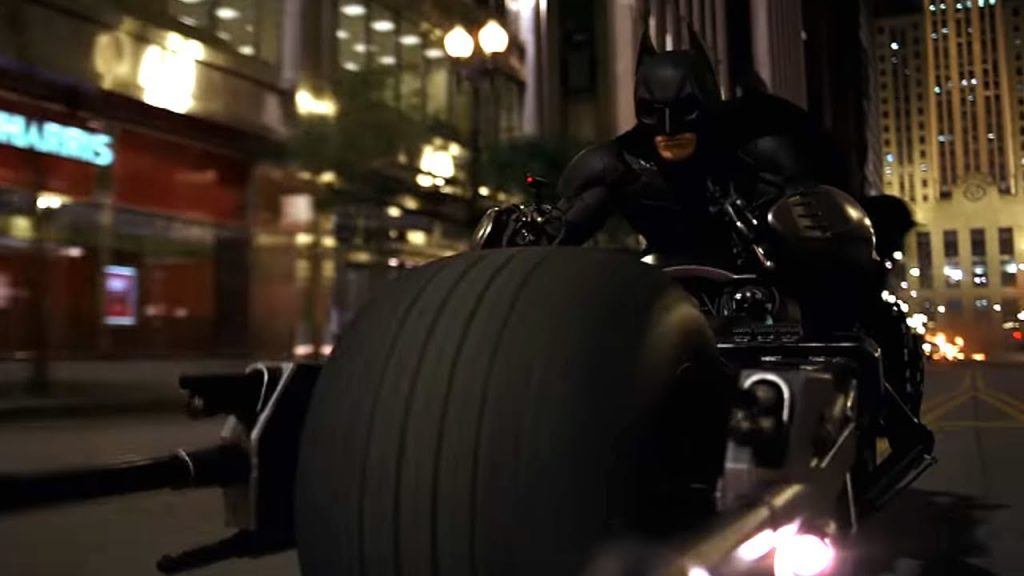 The Dark Knight - or The Batman - on ihs Batbike, or mobile, or something.