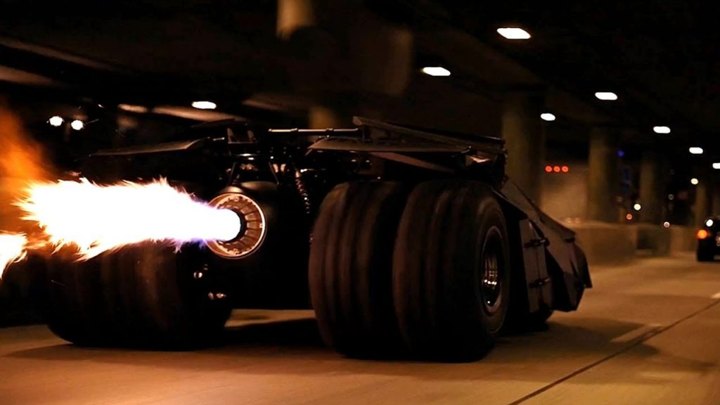 Look at that Batmobile. The design used in the Dark Knight, first introduced in Batman Begins, was totally new