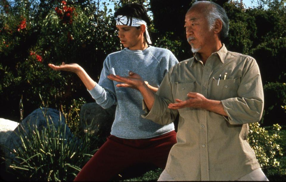 Daniel LaRusso and Mr. Miyagi training in the classic 80s family film the Karate Kid