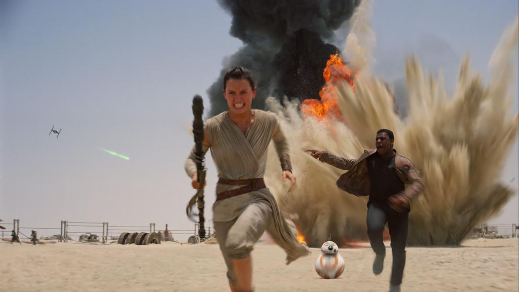Rey and Finn run from the First Order in The Force Awakens, the best Star Wars film in the recent trilogy.