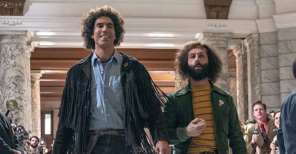 Sacha Baron Cohen as Abbie Hoffman and Jeremy Strong as Jerry Rubin