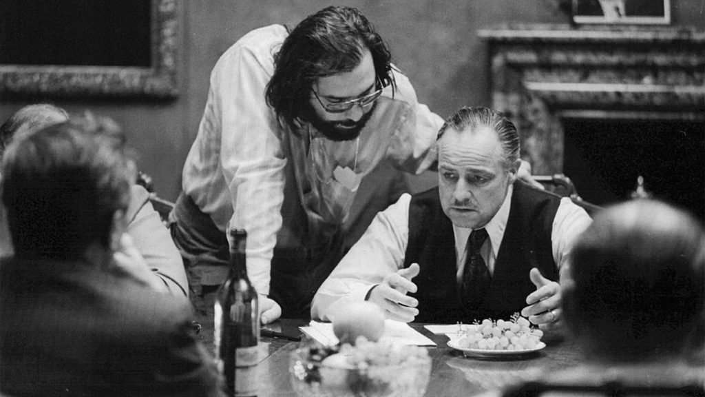 Francis Ford Coppola with Marlon Brando on the set of The Godfather