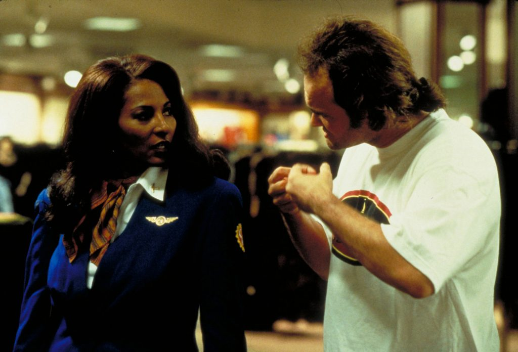 Pam Grier and Quentin Tarantino on set furing the shoot for Jackie Brown