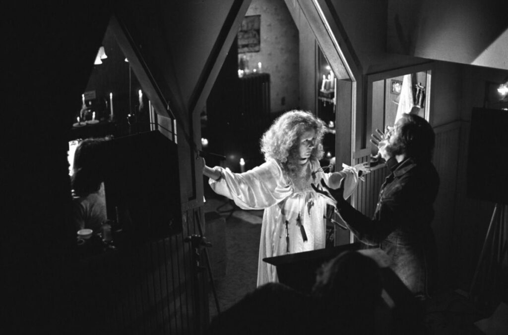 Piper Laurie and Brian De Palma on the set of Carrie (1976)