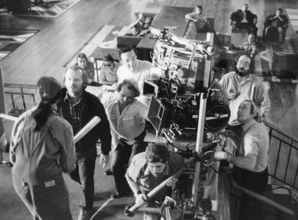 Stanley Kubrick oversees a shot on the set of The Shining (1980)