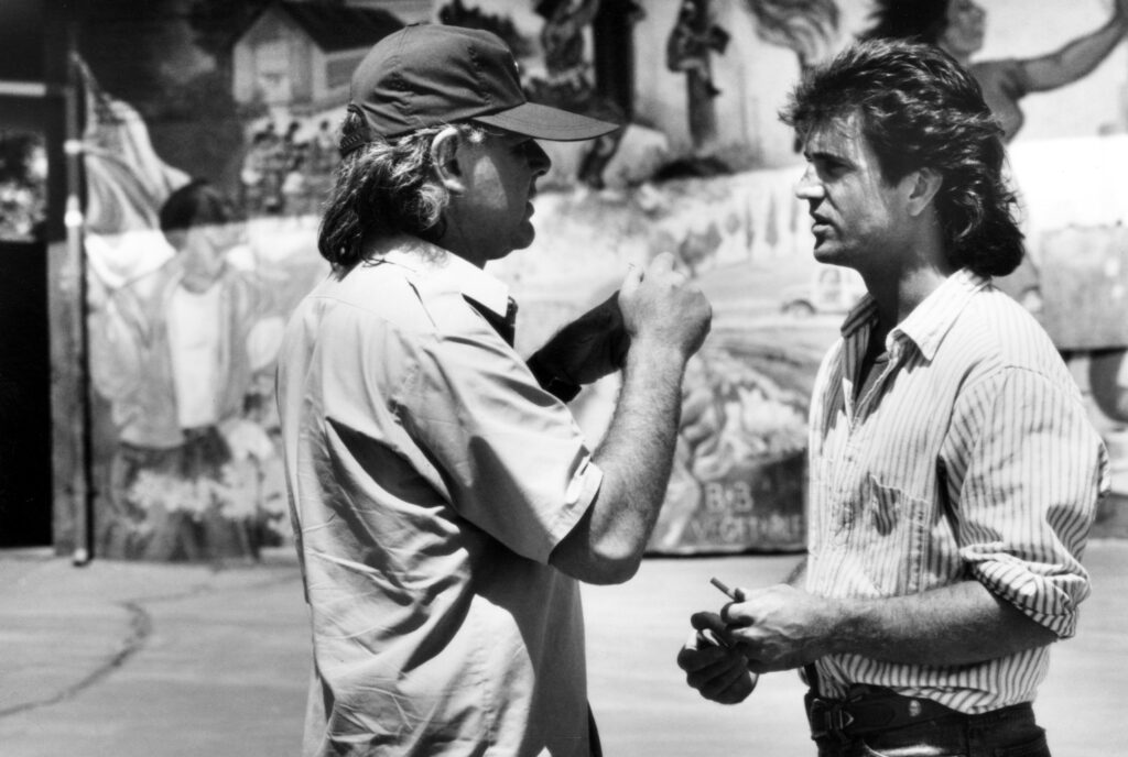 Richard Donner with Mel Gibson on the set of Lethal Weapon (1987)