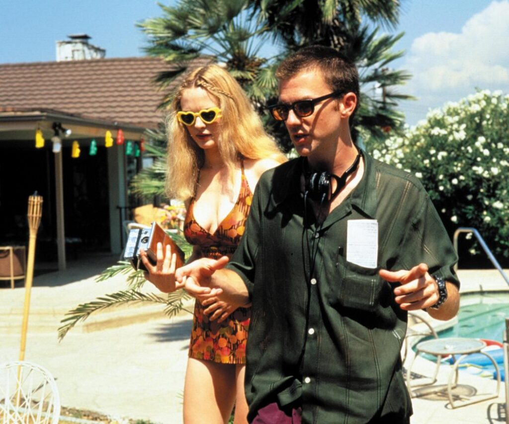 Paul Thomas Anderson and Heather Graham on the set of Boogie Nights