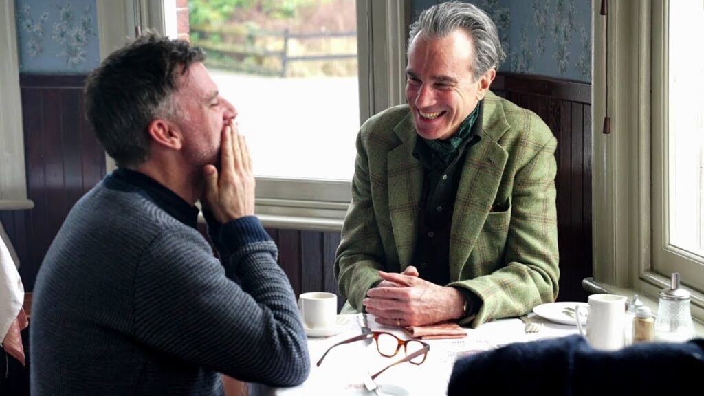 Paul Thomas Anderson and Daniel Day Lewis share a laugh on the set of Phantom Thread (2017)