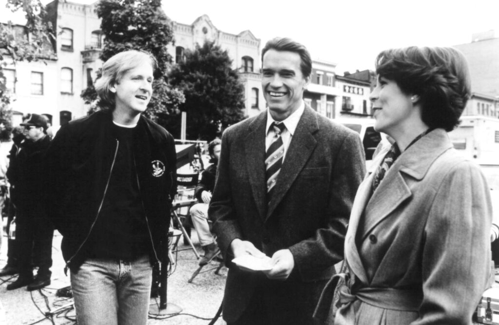 James Cameron with stars Arnold Schwarzenegger and Jamie Lee Curtis in the set of True Lies (1994)
