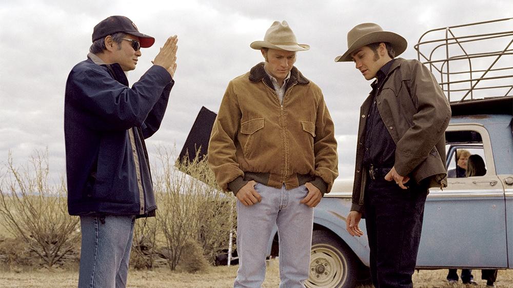 Ang Lee with Heath Ledger and Jake Gyllenhaal on the set of Crokeback Mountain (2005)