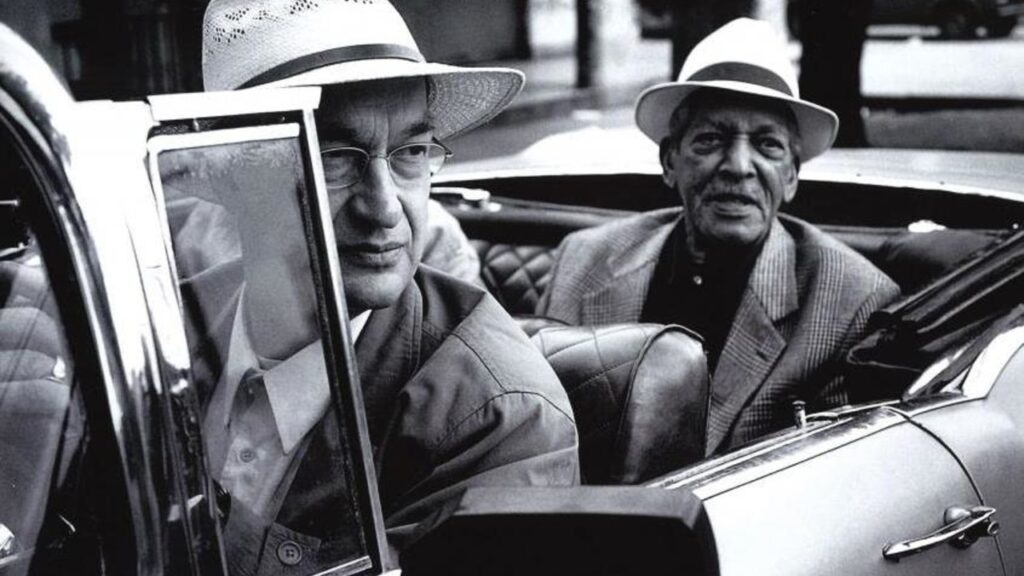 Wim Wenders drives a member of the Buena Vista Social Club (1999)