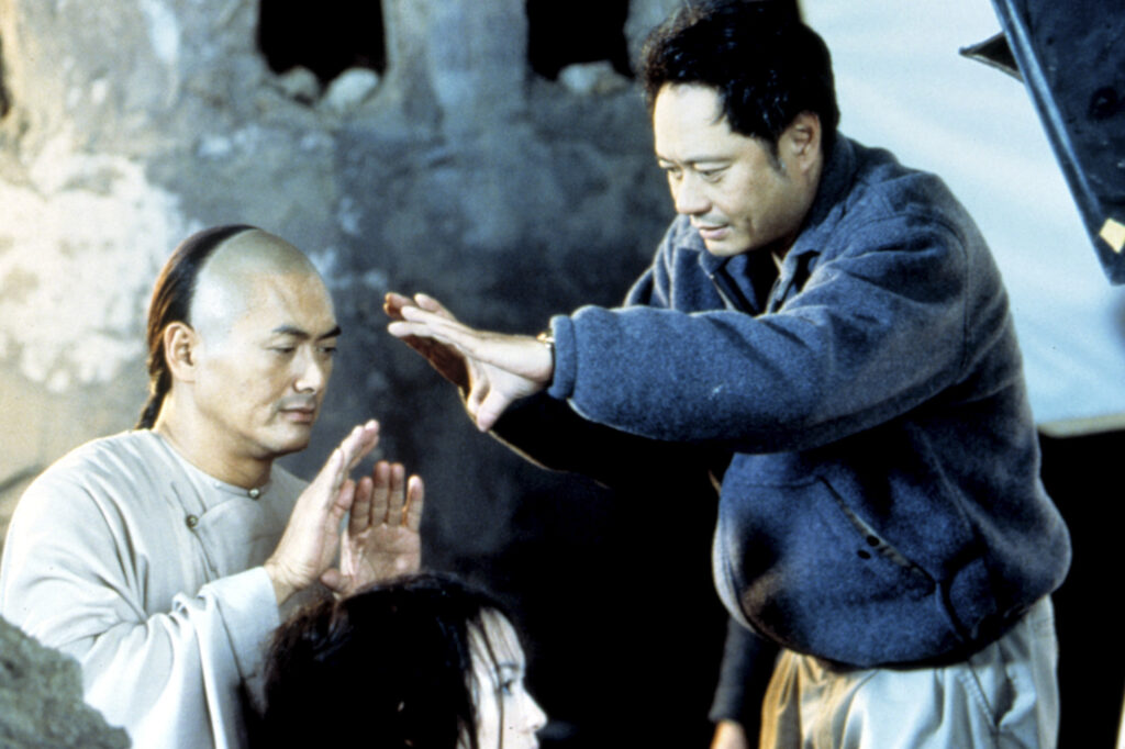 Chow Yun Fat and Ang Lee work on a scene during the filming of Crouching Tiger, Hidden Dragon (2000)
